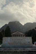 """Fuck Rhodes"" sprayed across the memorial in orange spray paint."