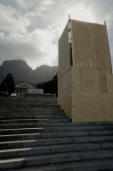 The Rhodes statue boarded up to protect it against further vandalism.