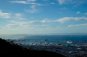 Cape Town's impressive harbour with Robben Island in the distance.