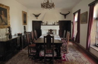 The dining room, complete with ancestral portraits and china.