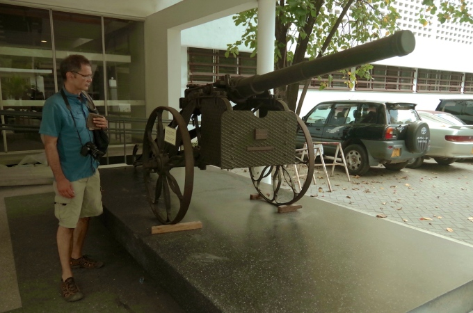 Walter outside the Museum, inspecting a German field gun at the entrance.