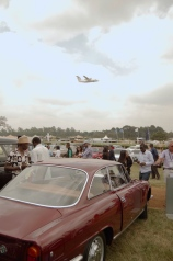Kenya Air does a fly-by over the show. An Alfa Romeo 2600 Sprint in the foreground.