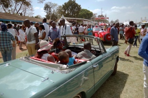 A Kenyan family in their Triumph Herald.